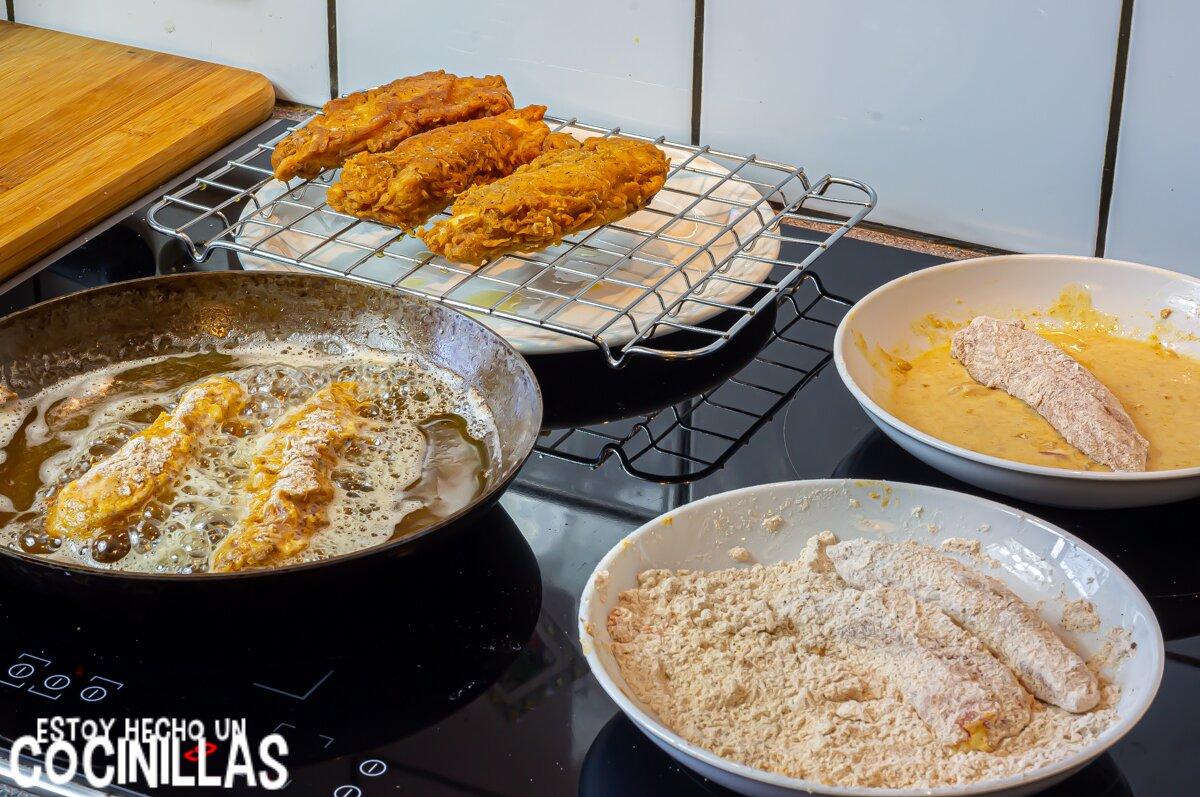 Cómo hacer tiras de pollo estilo Kentucky con rebozado crujiente